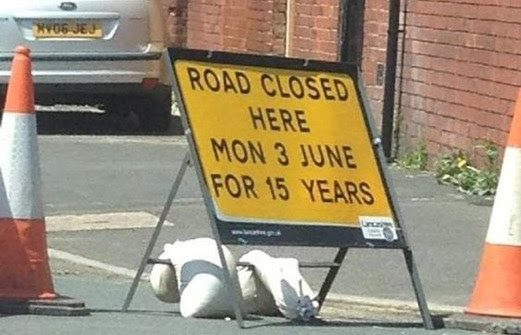 funny sign road closed for 15 years