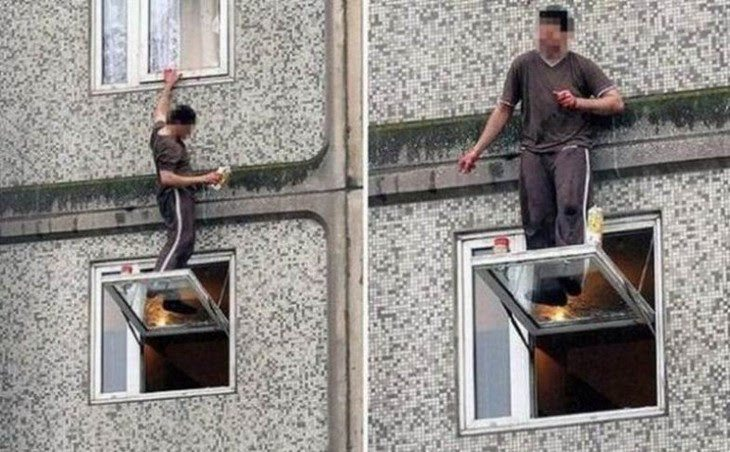 people standing on windows outside building