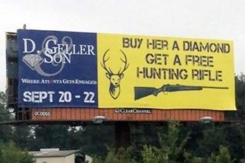 funny sign buy her a diamond get a free hunting rifle