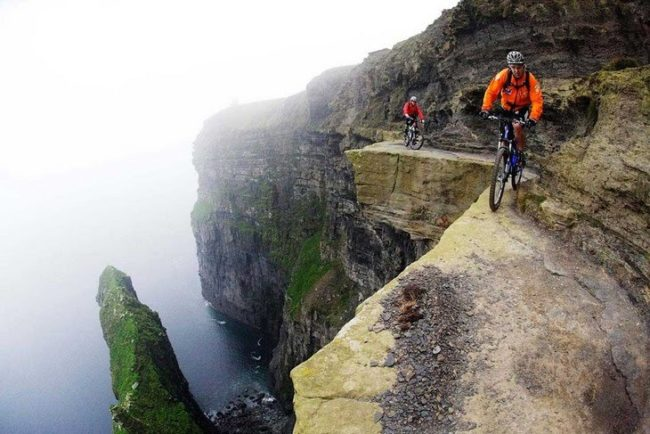 riding bikes on a high cliff stupid people